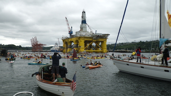 Kayakers gather for a day of protests against Shell Oil's presence on the Seattle waterfront.