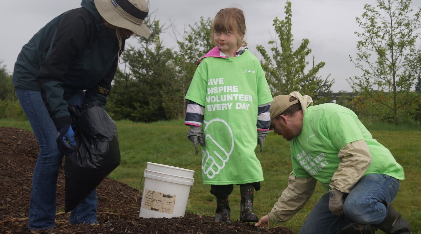 Volunteers clean up Union Slough, outside Everett.
