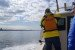 A volunteer scans the water during a Soundkeeper boat patrol.