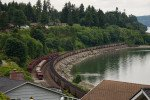 A coal train travels along the shoreline in Washington. Photo Paul K Anderson